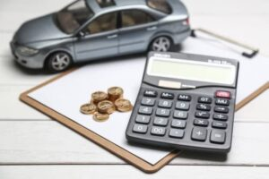 Travel Expenses Reimbursement (Calculator and Car with coins)